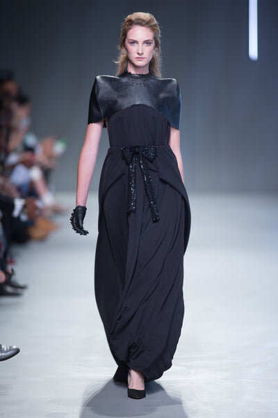 Black multiway Myri dress worn floor length worn with leather capelet and glovers