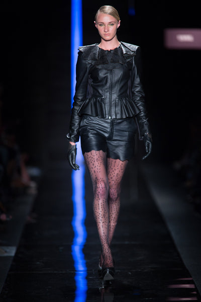 Black leather jacket with leather capelet and leather shorts