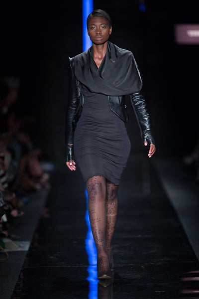 Black leather jacket over pencil dress with satin cowl