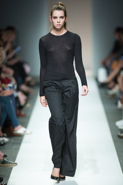 Black knit top and trousers