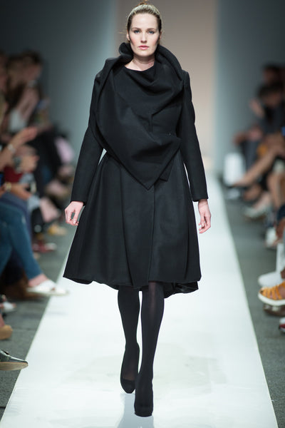 Black wool coat with draped collar detail