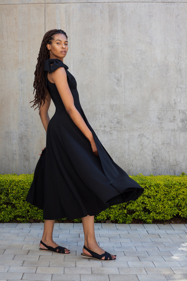 Black pencil dress with statement sleeves