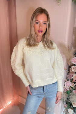 SERA CREAM KNIT WITH FLOWER DETAIL