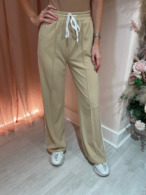BEIGE FLARED JOGGERS WITH WHITE STRIPE