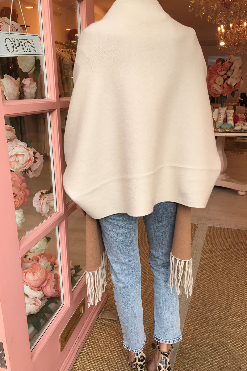 CREAM/BEIGE CAPE WITH TASSEL HEM