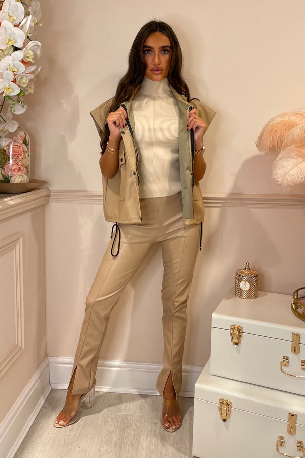 BEIGE FAUX LEATHER LEGGINGS WITH SLIT FRONT