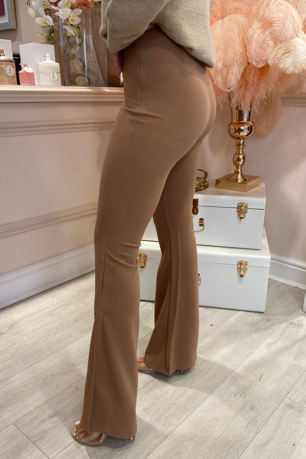 BROWN FLARED TROUSERS WITH SLIT BOTTOM DETAIL