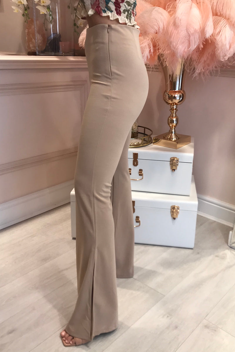 BEIGE FLARED TROUSERS WITH SLIT BOTTOM DETAIL
