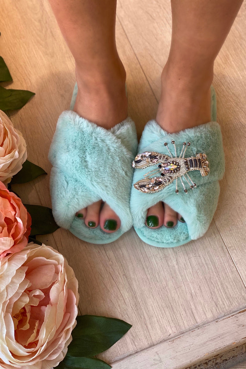 AQUA FLUFFY SLIPPERS WITH SILVER LOBSTER BROCH