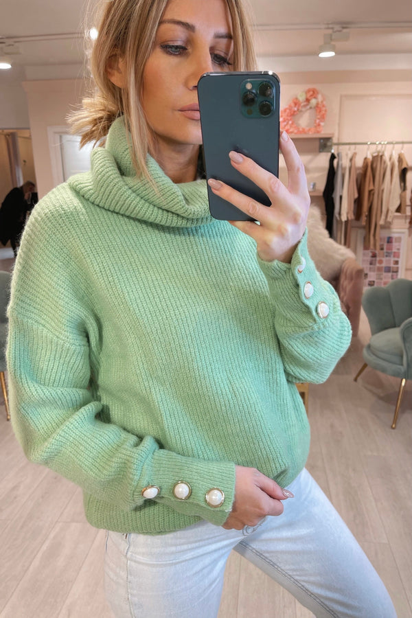 GREEN ROLL NECK WITH PEARL CUFF