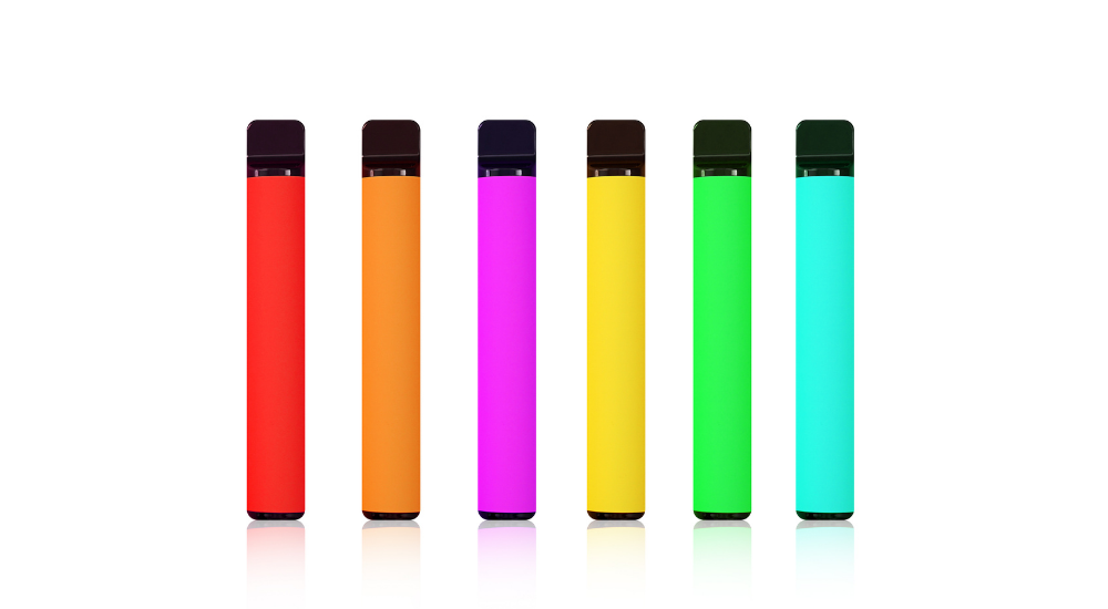 Multicolour disposable vapes in a row