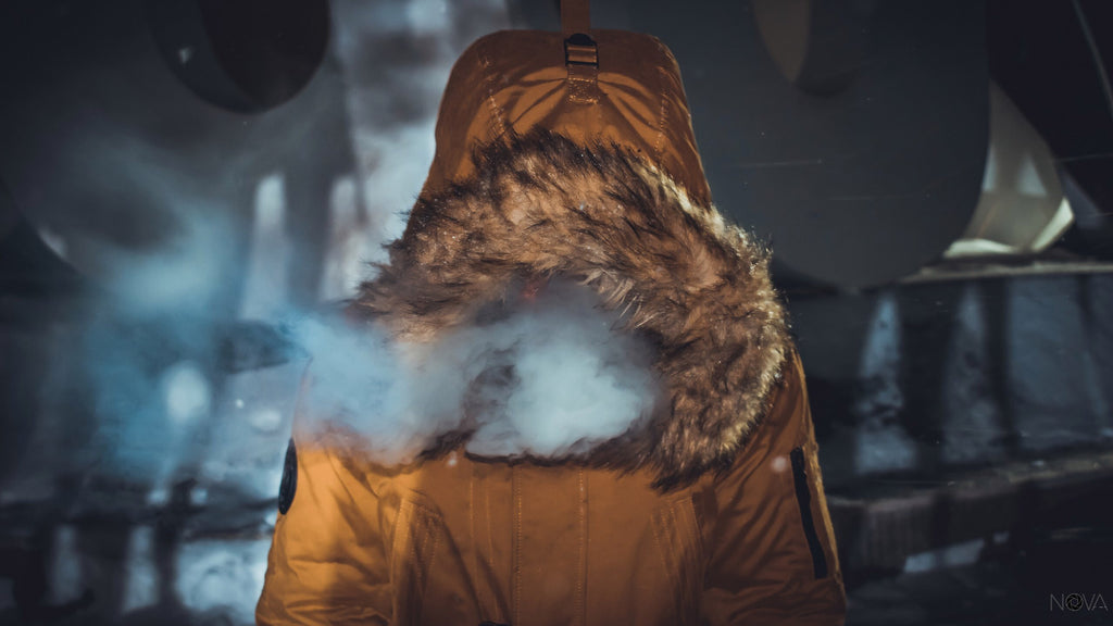 Someone vaping in a winter jacket