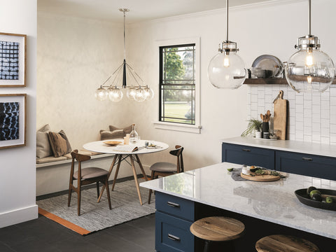 Kichler Globe Pendants over island, and matching chandelier at dining table