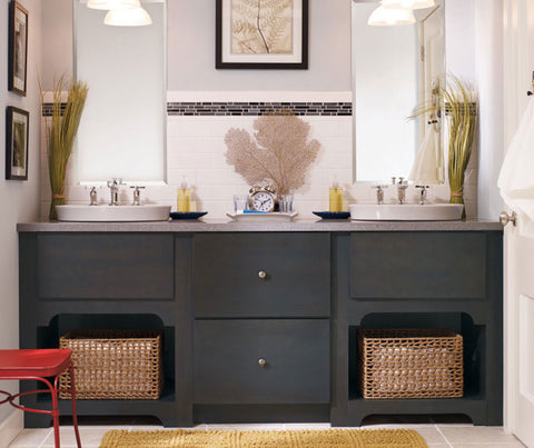 Dark gray vanity with two sinks and basket storage