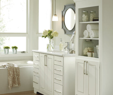 white traditional bathroom vanity and linen cabinet