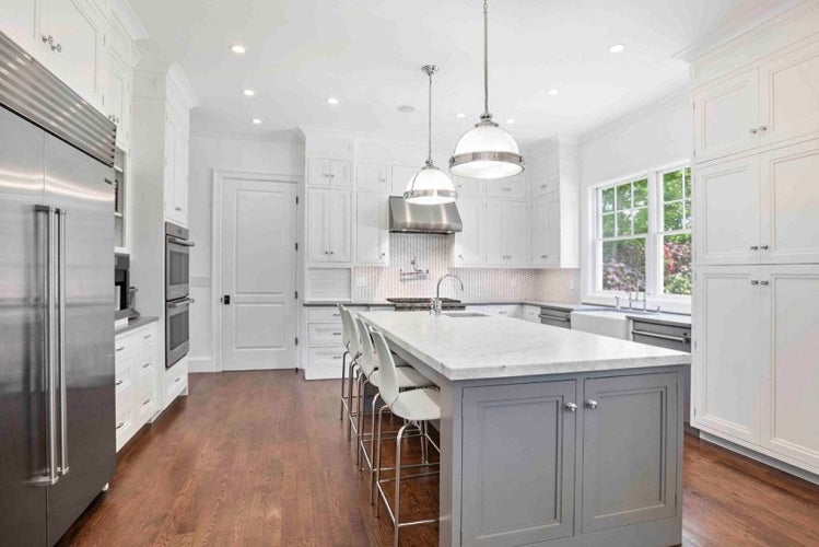 Kitchen remodel for resale. White and gray kitchen with kitchen island