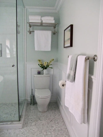 towel warmer or towel bar over the toilet