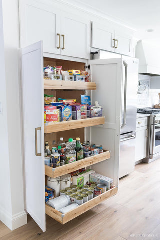 Pantry cabinet with roll out shelves by drivebydecor.com