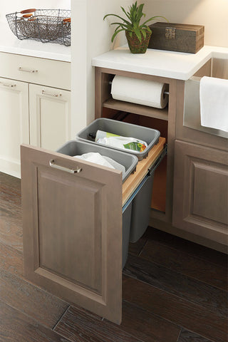 Double pull out trash cabinet with paper towel storage