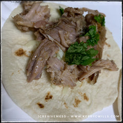 my bestie shared an amazing recipe for carnitas tacos and so i adapted this pork to fit the recipe. after 6 hours on low in the crockpot with a little mesquite marinade with lime i shredded it to bits! then loaded it in a street taco sized tortilla, added some cilantro and a squeeze of lime and a little shredded white cheese. doesn't look like much, but man is it delicious.