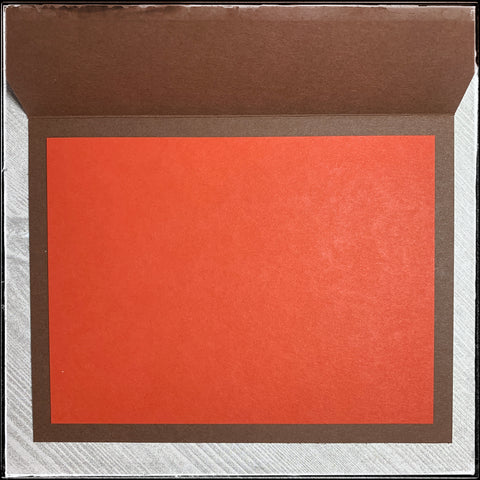 inside detailed photo of the handmade wishing you a season of blessings card. brown card base with a red orange interior to ensure the sender's message is clear to the recipient.