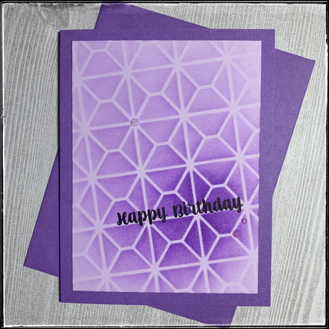 a flatlay view of the monochromatic purple handmade birthday card, complete with a purple envelope.