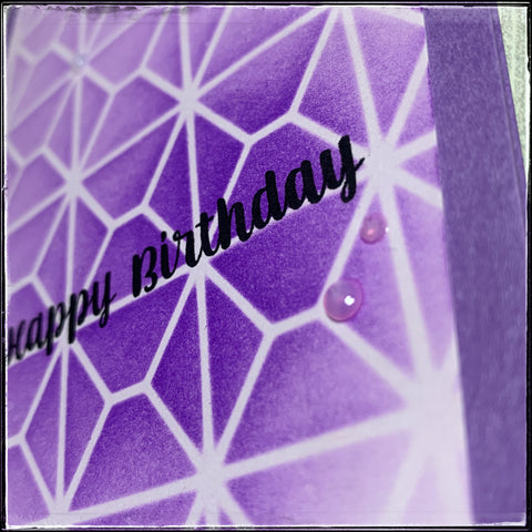an angled view of the card front showing the depth and dimension of the nuvo drops accents. they're slightly translucent liquid drops that will harden to create a dimensional detail in a circular shape.