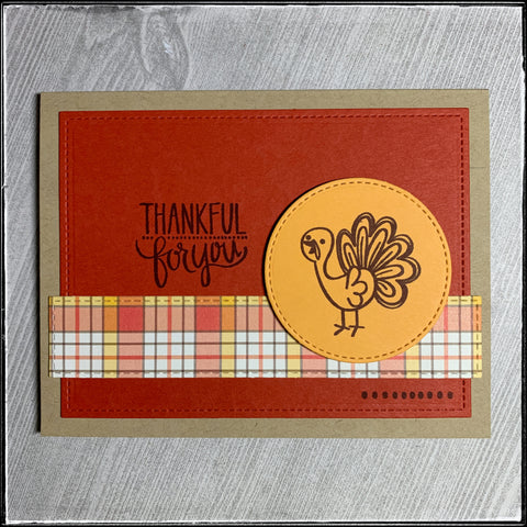 "flat lay image of the card front - complete with the sentiment ""thankful for you"" and a happy turkey. the turkey appears to be hand drawn but is actually stamped."