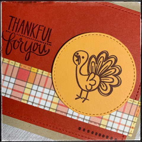 up close detail of the die-cut circle element that's elevated off of the card base with foam tape, and is stamped in brown ink with a playful turkey image.