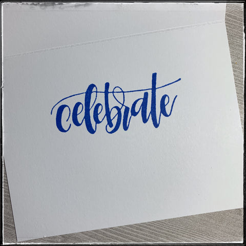the inside of the card features the word celebrate, stamped in the same dark blue as on the front of the card. it's in a scripty, flowy font and there's plenty of room for a personal message or sentiment to be included.