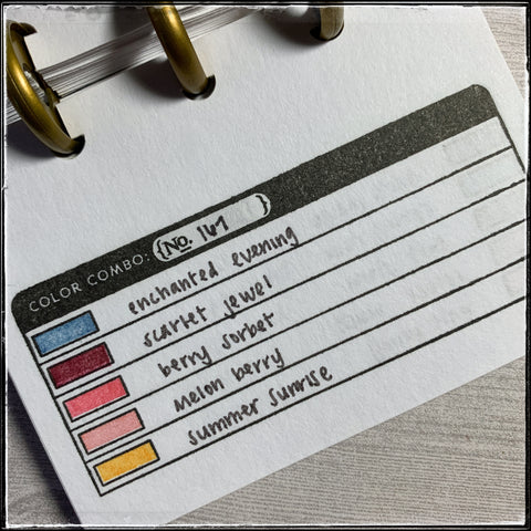 the mini swatch book i use for helping select color combinations. five colors are sampled in small blocks with their names written next to them. in this book, i've used various combinations of colored ink from the papertrey ink company.