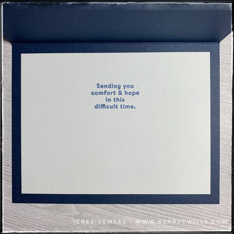 """The inside of this sympathy card has a light grey panel so your message will be visible to the recipient. In the middle of the panel is the sentiment which reads """"Sending you comfort & hope in this difficult time."""" and is stamped in dark blue ink coordinating with the card base. When this type of card is required, the thought in sending it is what is so important."""