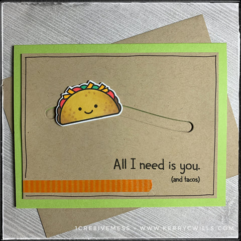 "Every taco lover out there will appreciate this handmade card! In addition to a fun sentiment, ""All I need is you. [and tacos]"" there's a smiling taco that slides back and forth across the card front! A green card base lies below the kraft panel that's elevated off of the card base to allow the taco to slide back and forth. The taco has been stamped, die-cut and colored with Prismacolor markers. A small strip of orange striped washi tape adorns the lower left portion of the kraft panel, alongside hand-drawn black lines around the perimeter of the card."