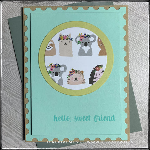 """""""hello, sweet friend"""" is stamped in aqua ink on an aqua panel that's elevated off of the kraft card base. The border around the panel is designed to look like a postage stamp. Centered on the panel is a die-cut soft green circle that's layered with a smaller circle in a fun animal pattern. The animals all have flowery headdresses and are super cute. A grey envelope is shown as well and is included with this handmade friendship card."""