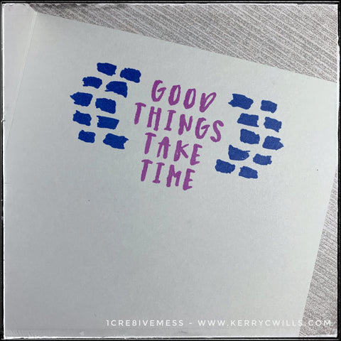 """The inside of this handmade card has a secondary sentiment which coordinates with the front of the card. """"Good things take time"""" is stamped in purple ink near the top middle of the card and on either side are the same small blue dashed lines as on the front of the card."""