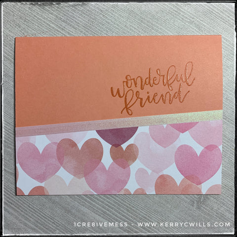 A flat-lay of the wonderful friend card in this all occasion handmade card set. A light melon card base coordinates with the colors of hearts on the patterned paper section of the card and is accented by a narrow strip of iridescent vellum.
