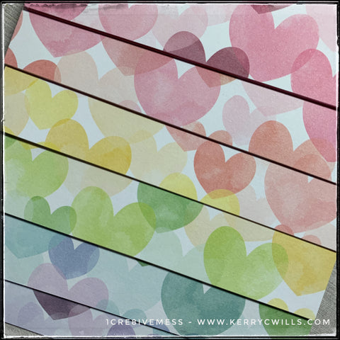 Details of the watercolor-esque pattern on this set of handmade all occasion cards. A rainbow of hearts in overlapping colors and sizes, this pattern is just so cheerful. A gorgeous set, these would make an excellent gift to anyone who enjoys sending [or receiving!] snail mail.