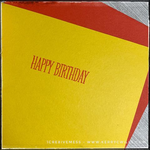 """The inside of this handmade celebratory card continues the party with the stamped sentiment """"Happy Birthday."""" It's stamped in the same red ink as seen on the front of the card and coordinates with the colored envelope that's included."""