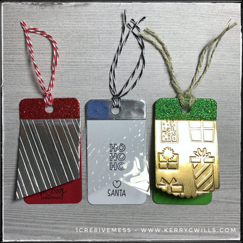 Three holiday tags featuring some embossed designs for added texture. Foil and glittered papers make these two-layer tags that next level of extra to make your holiday gifts super special.