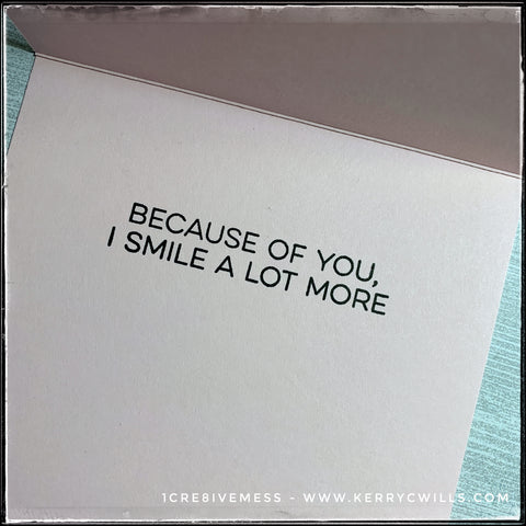 "The inside of the card features the sentiment ""Because of you, I smile a lot more"" stamped in black ink against the pale pink card base."