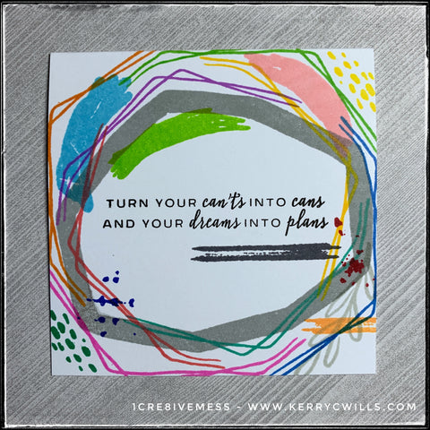 "This square card is full of overlapping lines in a rainbow of colors, all surrounding the sentiment, ""Turn your can'ts into cans and your dreams into plans"" which is stamped in bold, black ink in the center of the card front."