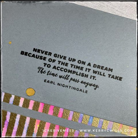 """Focusing on the sentiment on this card front, this photo shares a snippet of the colored detail beneath the sentiment which is stamped in black ink: """"Never give up on a dream because of the time it will take to accomplish it. The time will pass anyway. - Earl Nightingale"""""""