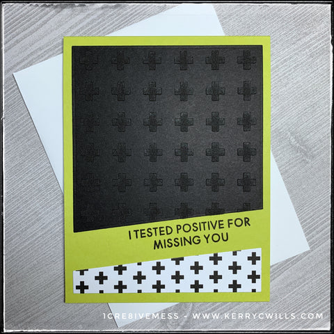 "Utilizing a split die-cut, today's card features a subtle textured pattern in addition to some patterned paper and a super bold background. The top portion of the card is black with tone on tone matte plus signs that are dimensional due to texture paste. The bottom portion of the card has a similar pattern, only this time black on white. Between the two sections, stamped on an angle is the sentiment, ""I tested positive for missing you"" in black ink. The card base is bright green and comes with a white envelope."