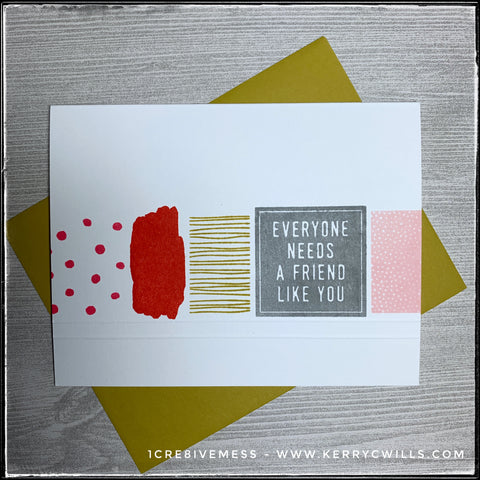 """A handmade card designed to make everyone feel like the best friend ever, this card features a horizontal row of blocks with different patterns. Polka dots, paint swashes, stripes and tiny reverse polka dots accent a bold block with the sentiment """"Everyone needs a friend like you."""" A saffron colored envelope is also shown and is included."""