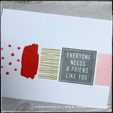 """An angled view of the design on this card front, the horizontal row of patterned blocks fills the frame. Large, sporadic polka dots, a brushstroke, wonky lines and reverse polka dots surround the main bold block that houses the sentiment, """"Everyone needs a friend like you."""""""