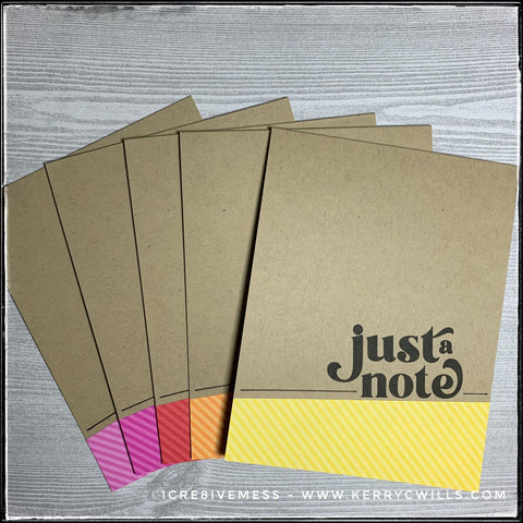 """A rainbow of pink, red, orange and yellow diagonally striped patterned papers accent the stamped sentiment, """"just a note"""" on this set of handmade cards. The sentiment is stamped in black ink which is a nice contrast to the kraft colored card base."""
