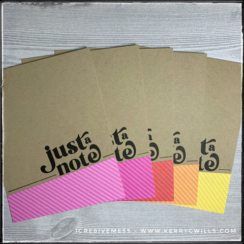 """A set of five handmade cards featuring pinks, red, orange and yellow diagonal stripes on a small section of patterned paper. The card base is kraft colored and the sentiment """"just a note"""" is stamped in black ink."""