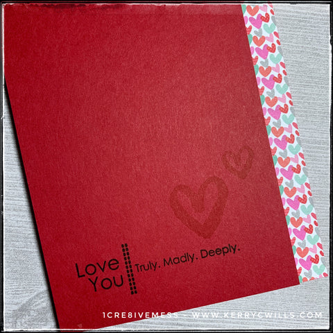 "An angled view of the details on the card front, you can see the stamped sentiment which reads ""Love You 