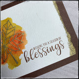 A close up of the detail on the front panel of this card, featuring a torn edge that's been heat embossed with gold powder on this handmade card from 1cre8ivemess.