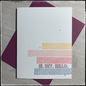 "Four colorful blocks of alphabet text line the lower right side of the white card front. Between the third and fourth row is a single line of text which reads ""hi. hey. hello."" Three small clear 3D dots accent the front, creating a visual triangle. A wine colored envelope is included and coordinates with the main sentiment color."